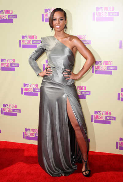 Alicia in in a silver one sleeved high slit Alexandre Vauthier gown