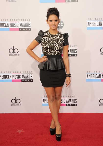 Rocsi Diaz in a black & white peplum & dramatic shoulder mini dress