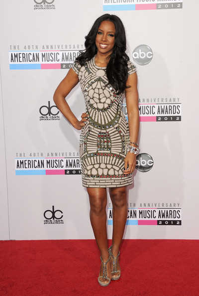 Kelly Rowland in a Naeem Khan Fall 2012 dress embellished with mirrored stones and felt applique